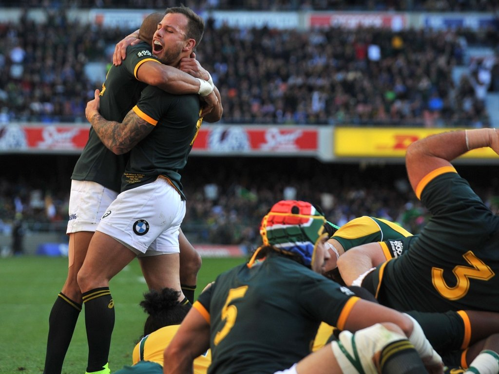 The Bok backs celebrate after the forwards scored the first try