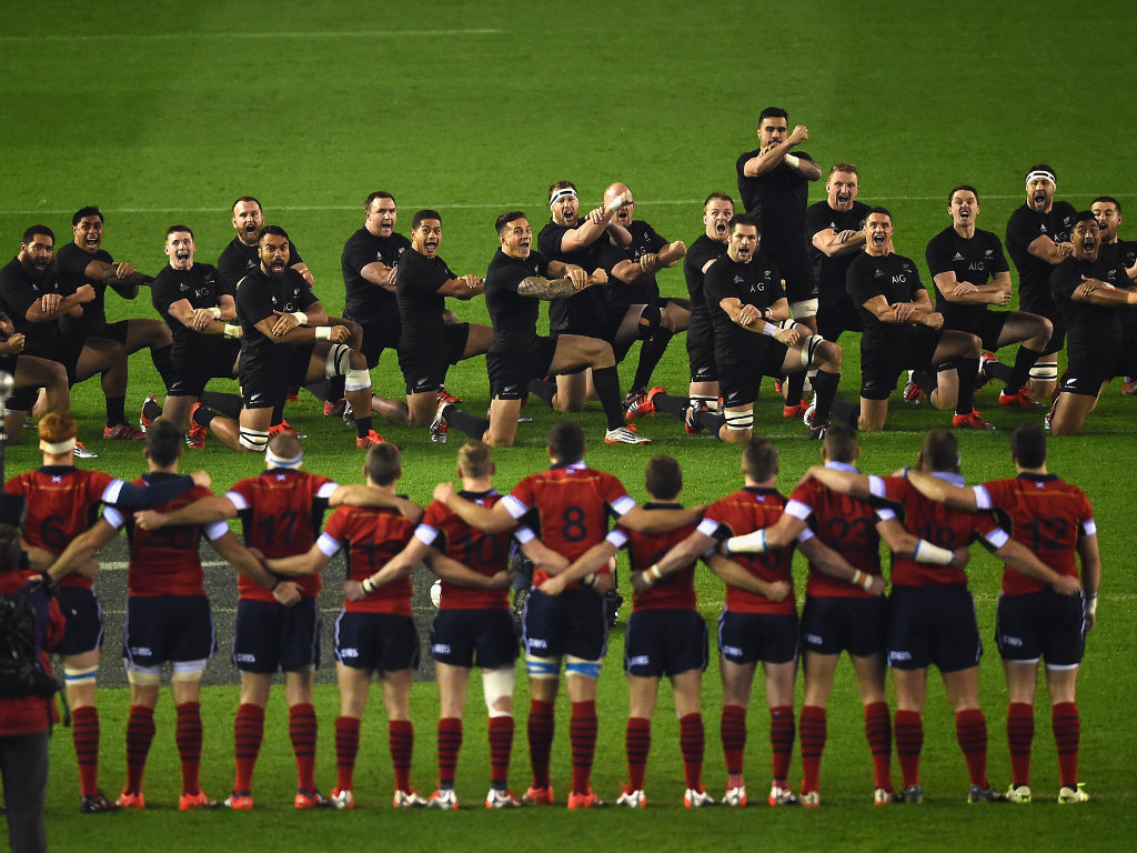 Face off: The Scots stare down the All Blacks during the haka