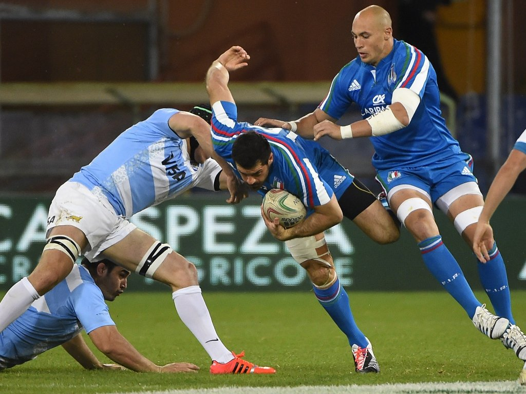 Helping hand: Italy full-back Andrea Masi almost through