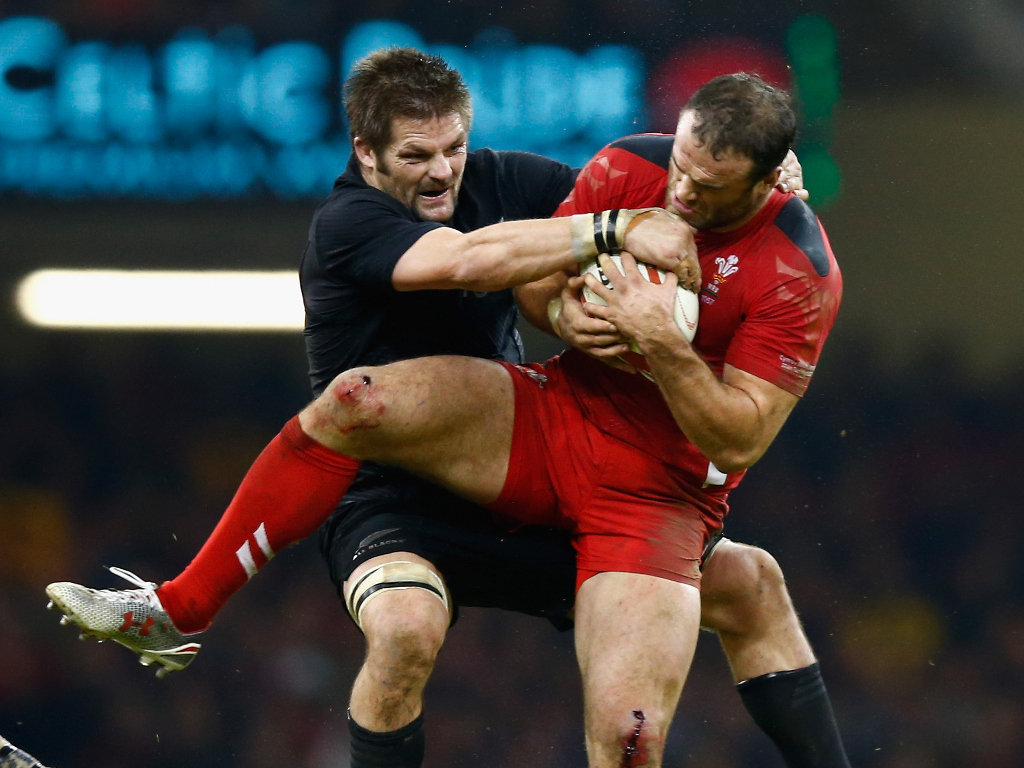 Mid-air battle: Richie McCaw and Jamie Roberts