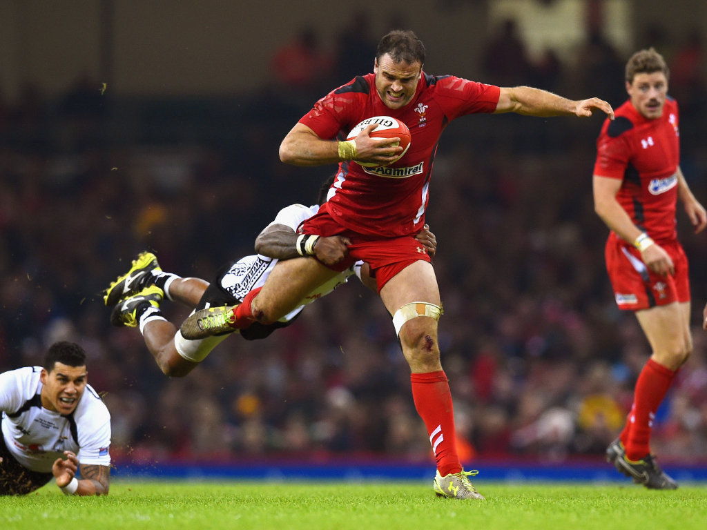 Hanging on: Jamie Roberts on the charge
