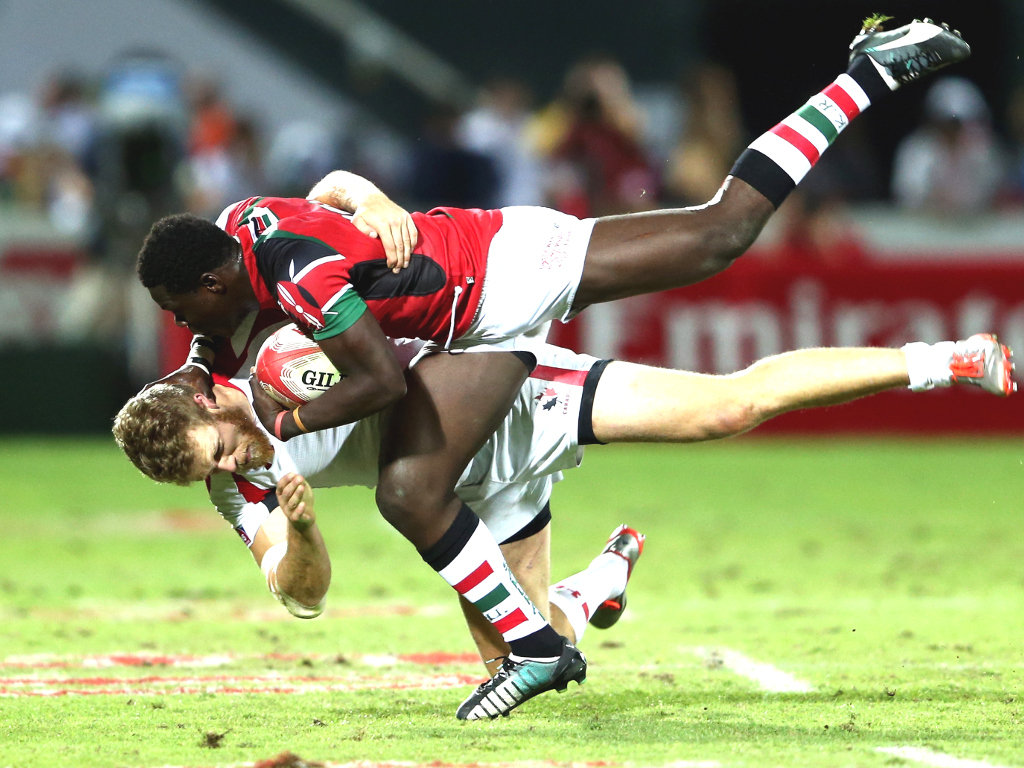 Head on collision: Kenya's Alex Olaba and Connor Trainor of Canada in the Shield Final