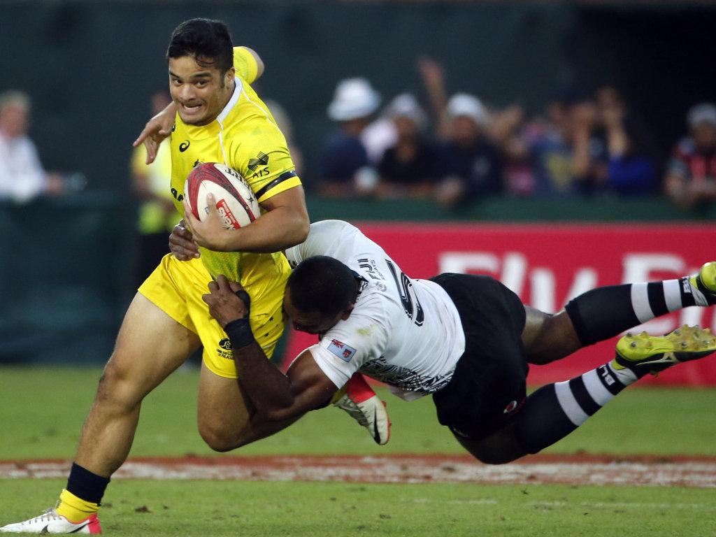 Gotcha!: Allan Fa'alava'au of Australia can't escape the attentions of Fiji's Isake Katonibau in their semi-final