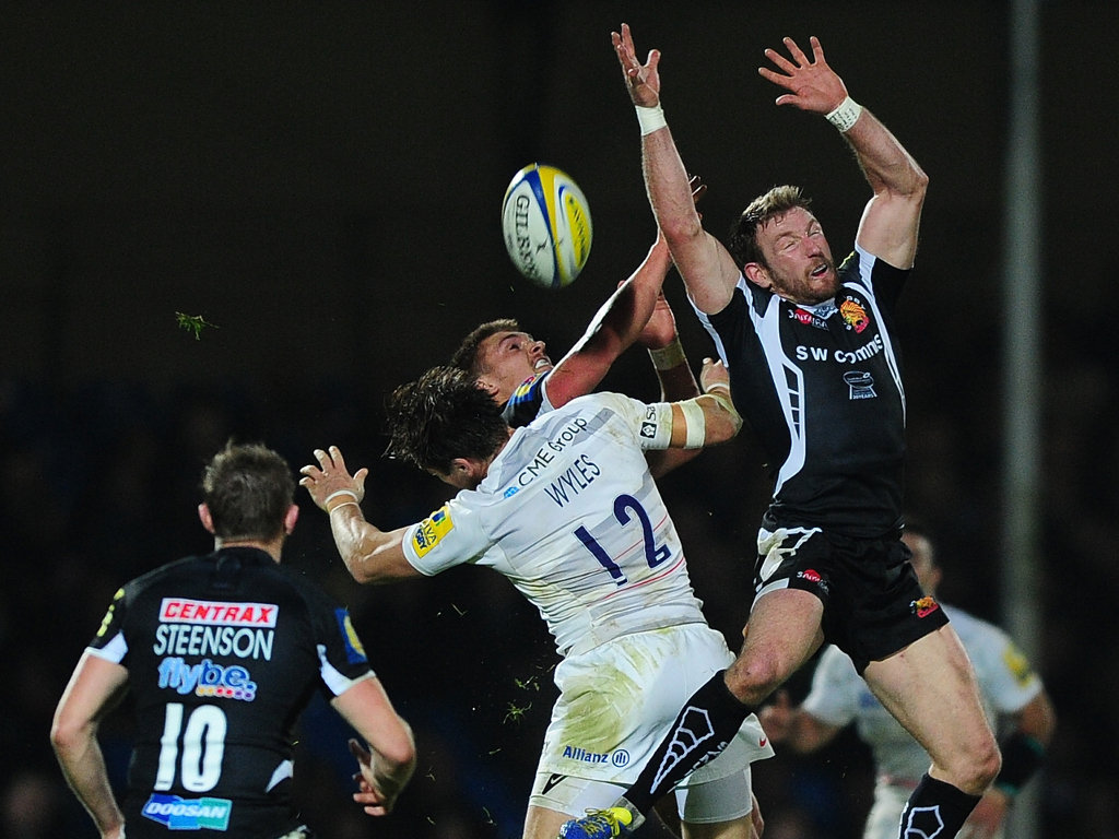 Aerial duel: Exeter's Henry Slade and Matt Jess compete for a high ball with Chris Wyles of Saracens