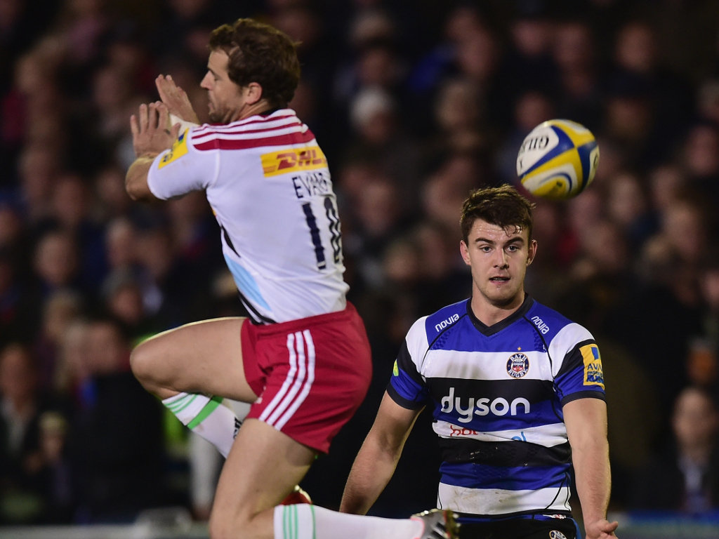 Harlequins' Nick Evans tries to charge down an Ollie Devoto chip kick