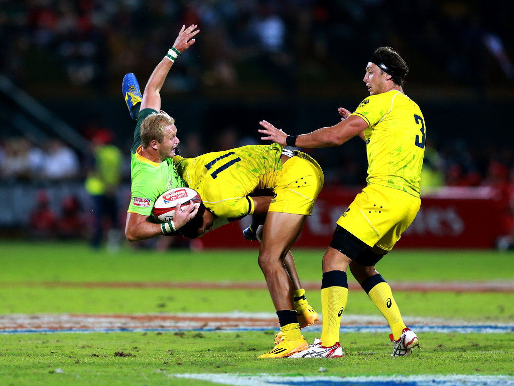 Taking a tumble:Australia's Pama Fou halts Philip Snyman of South Africa's progress in the final