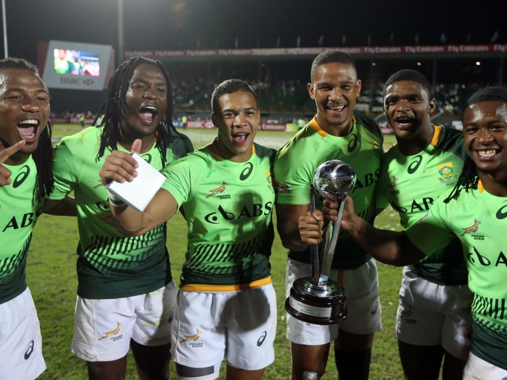 Some of the Blitzbokke show off the spoils of victory