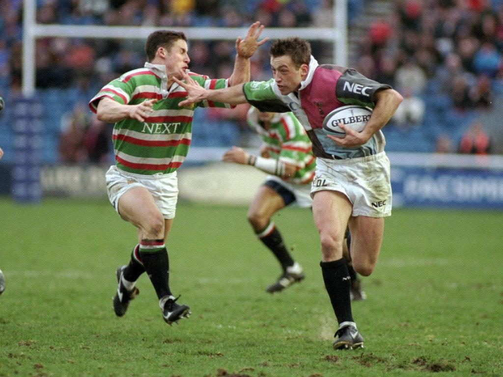 1999 Dan Luger of Harlequins hands off Craig Joiner of Leicester
