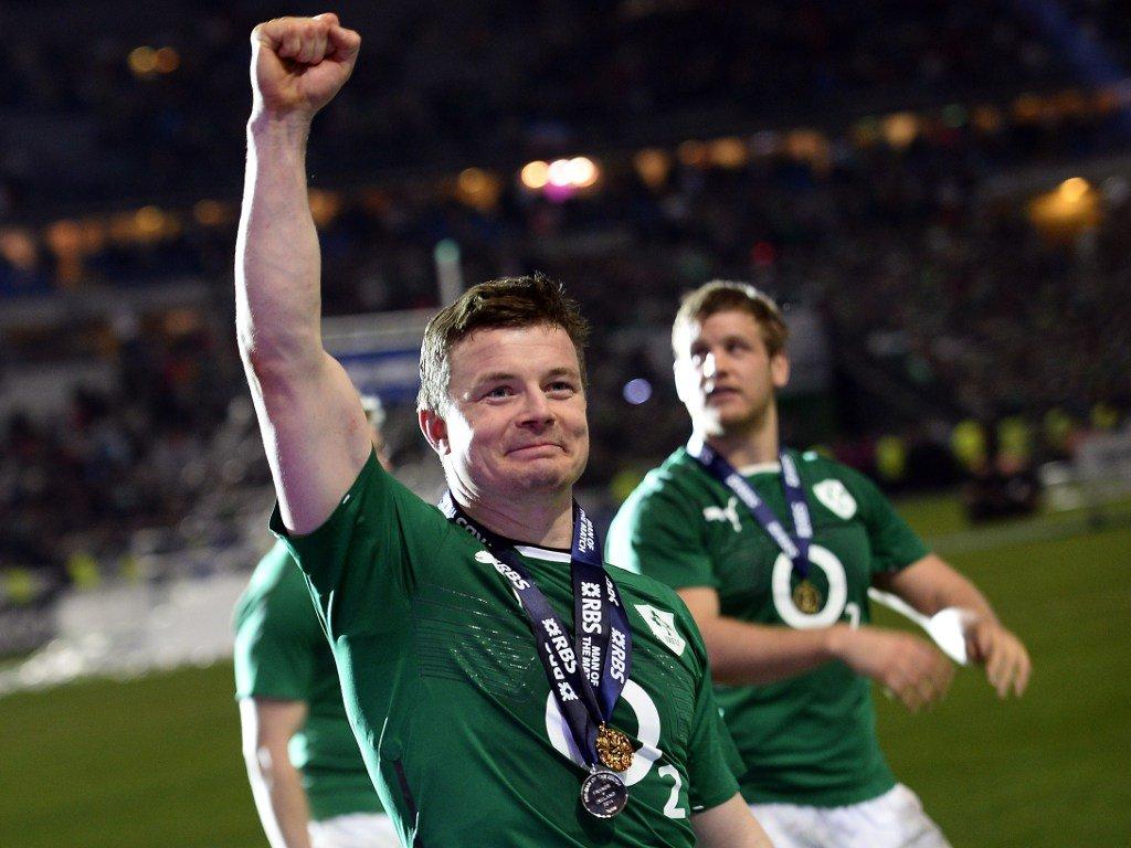 Brian O'Driscoll celebrates Ireland's Six Nations triumph in his final Test
