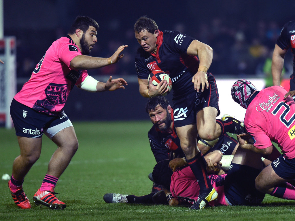 On the charge: Lyon's Deon Fourie
