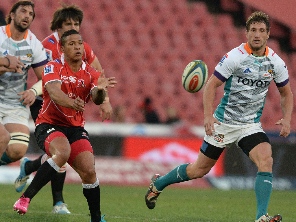 Elton Jantjies of the Lions feeds his line during his side's victory over the Cheetahs in Super Rugby's opening match