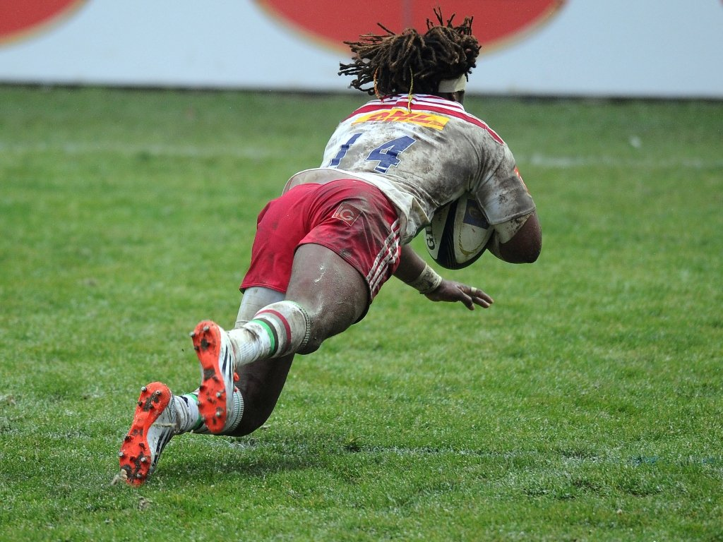 Over he goes: Harlequins wing Marland Yarde