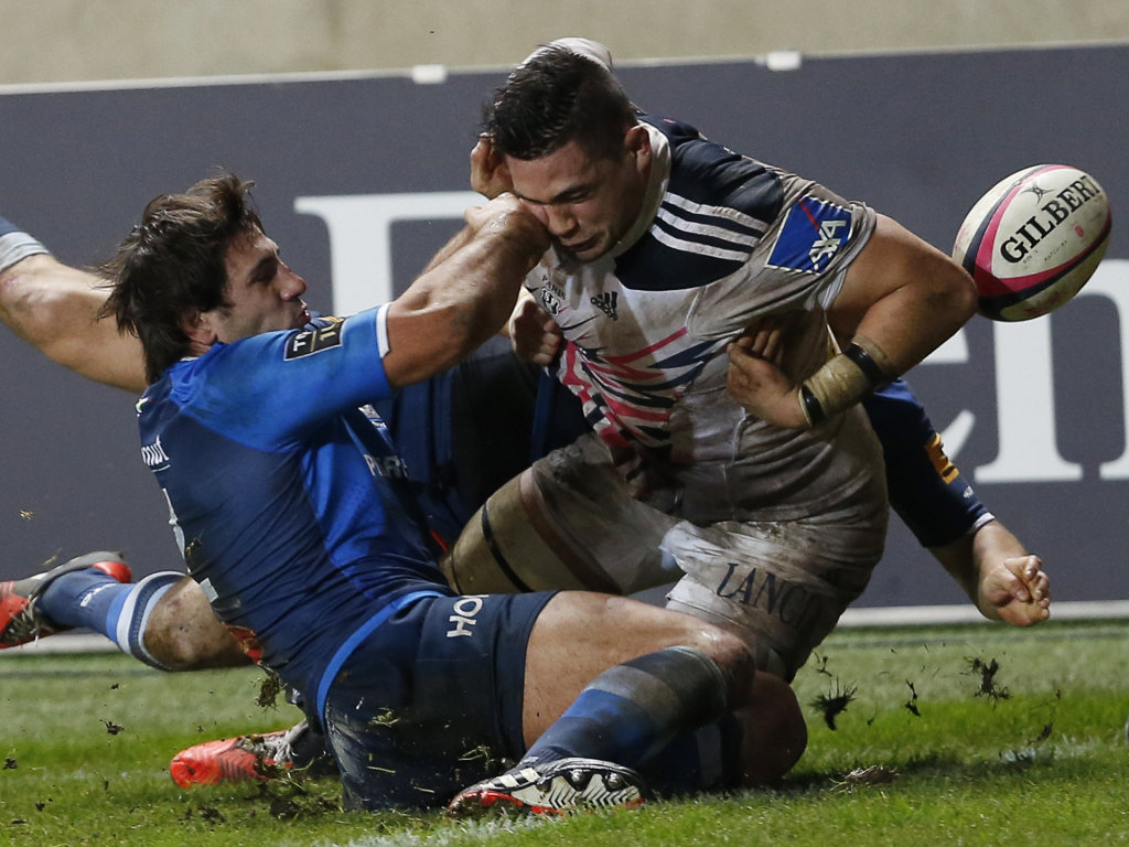 Stade Francais number eight Raphael Lakafia loses the ball in contact
