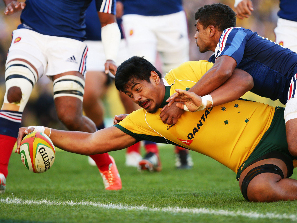 Will Skelton of the Wallabies bulldozes his way over the try-line against France