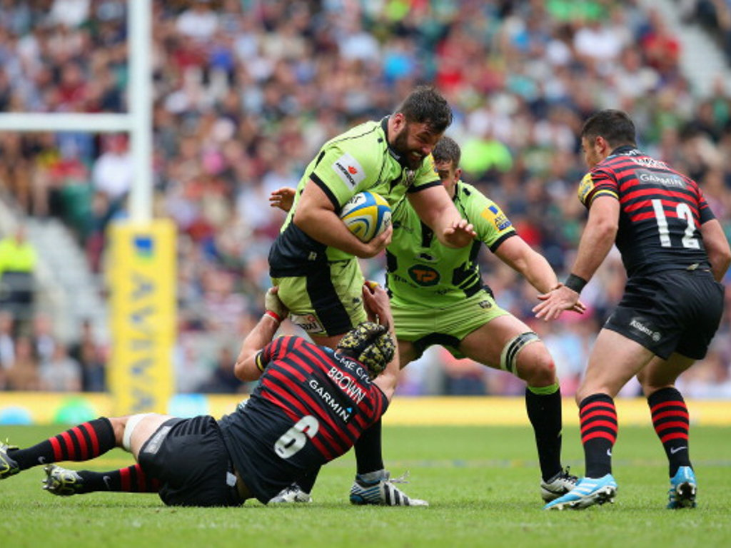 Saints' Alex Corbisiero clatters into Kelly Brown of Saracens in the Premiership Final