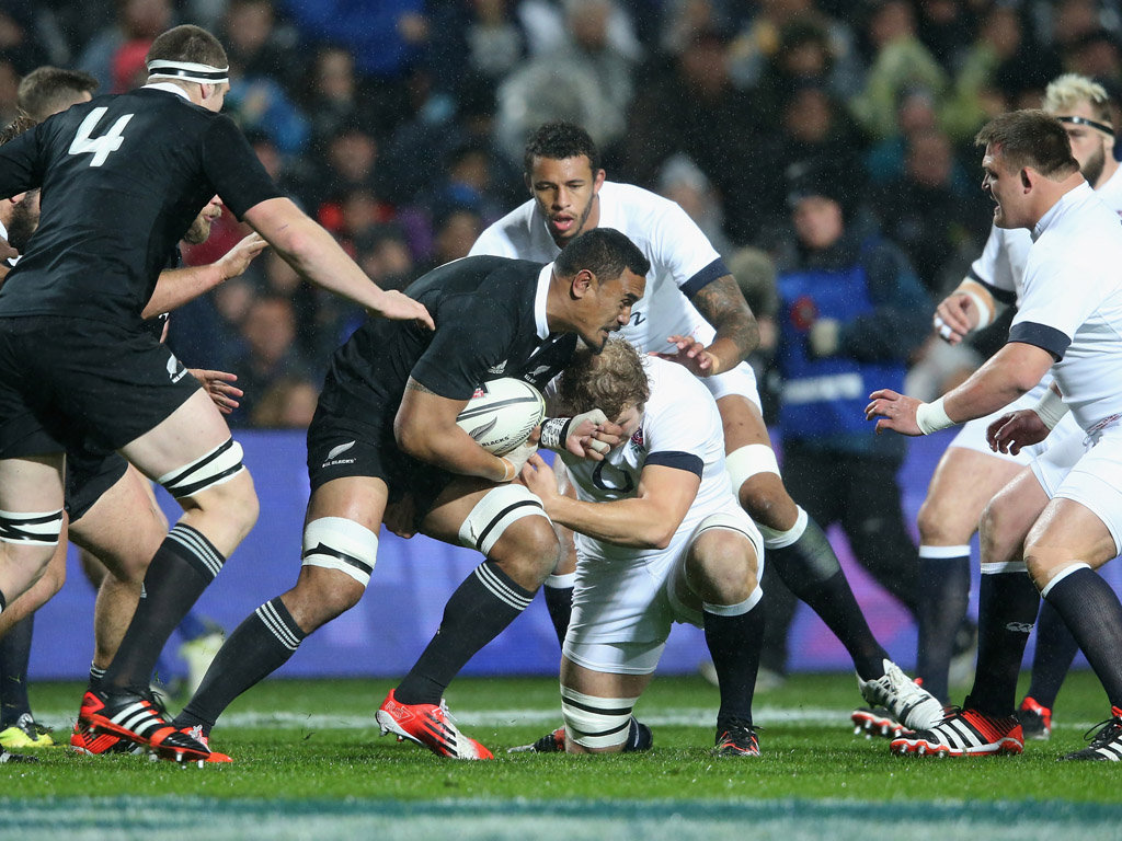 All Blacks enforcer Jerome Kaino charges in to Joe Launchbury of England