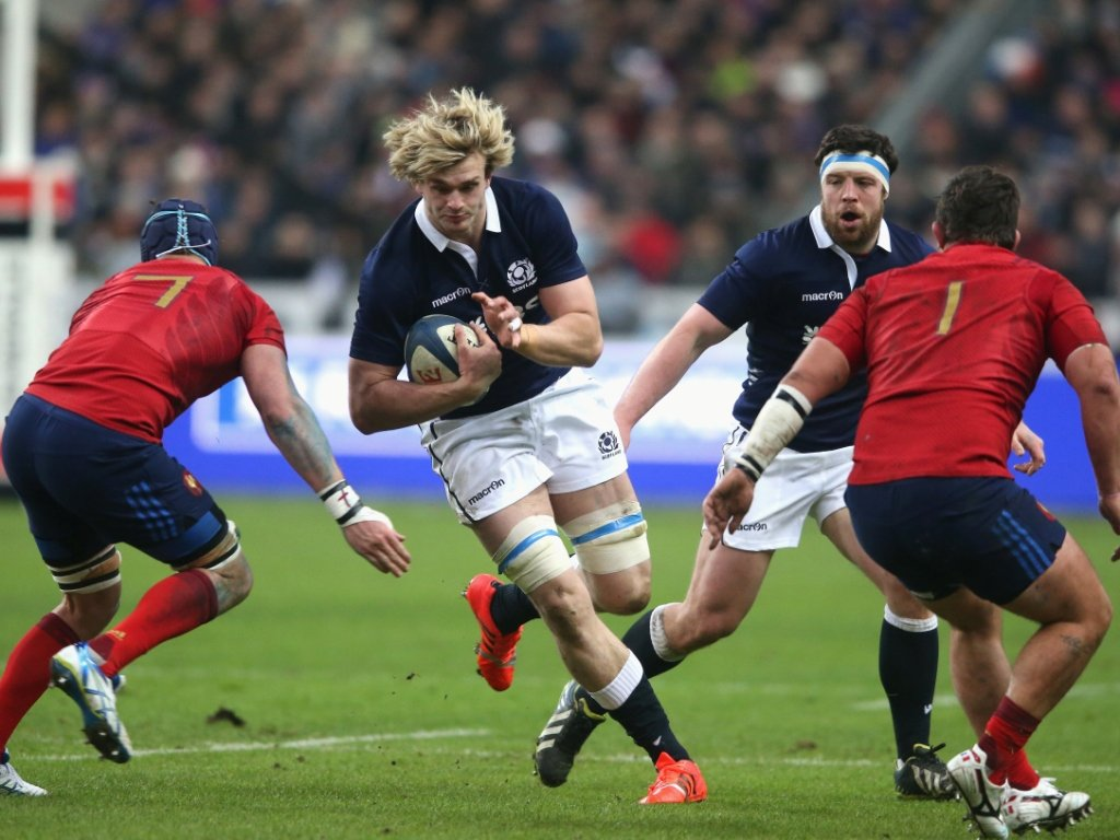 On the charge: Richie Gray tries to get away from the French defence