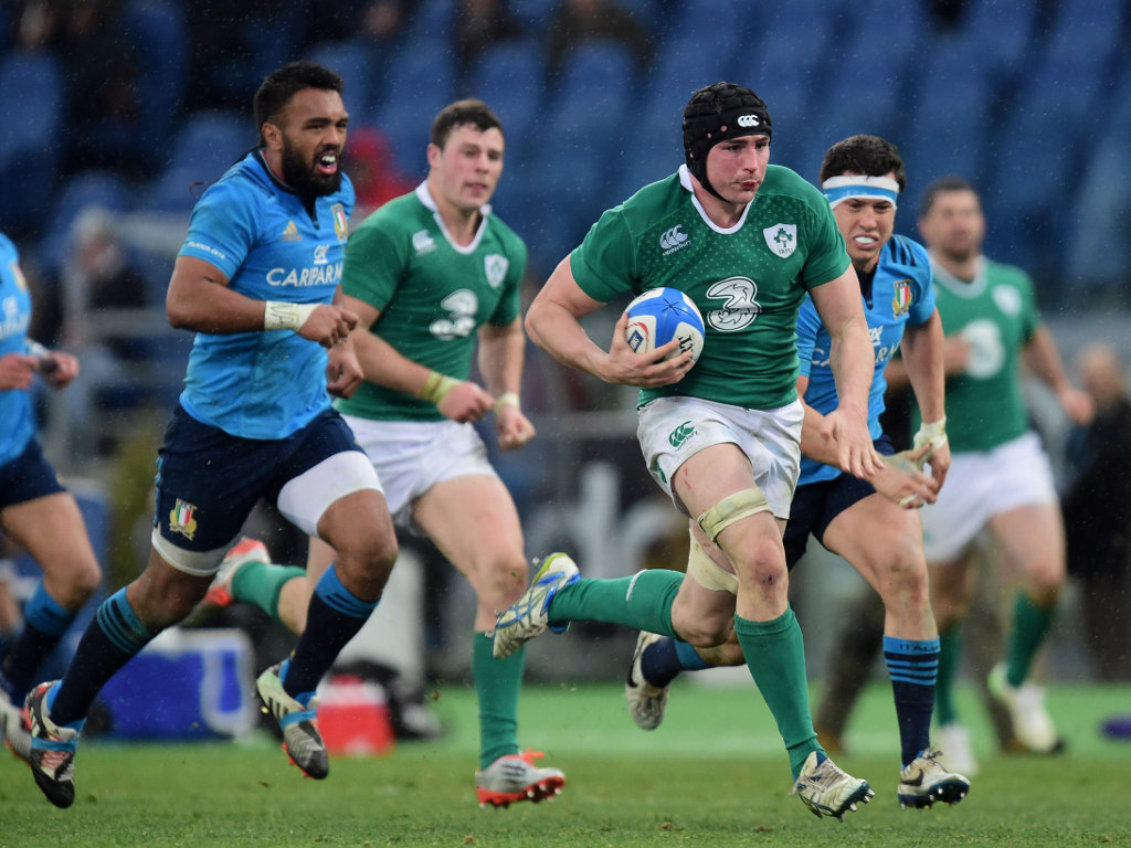 Tommy O'Donnell bursts through the Italy defence to score