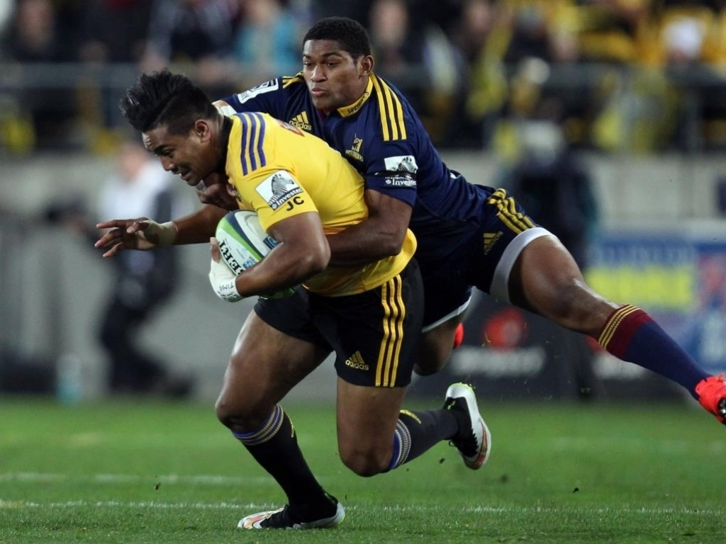 Waisake Naholo hangs on to Julian Savea